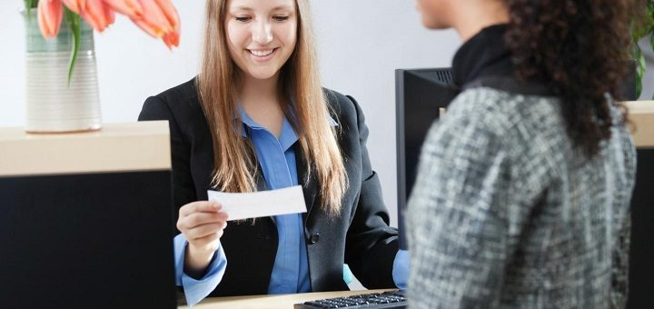 customer-being-helped-by-a-bank-teller