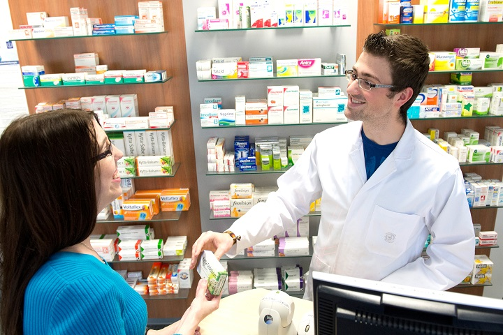 friendly-pharmacist-helping-a-client