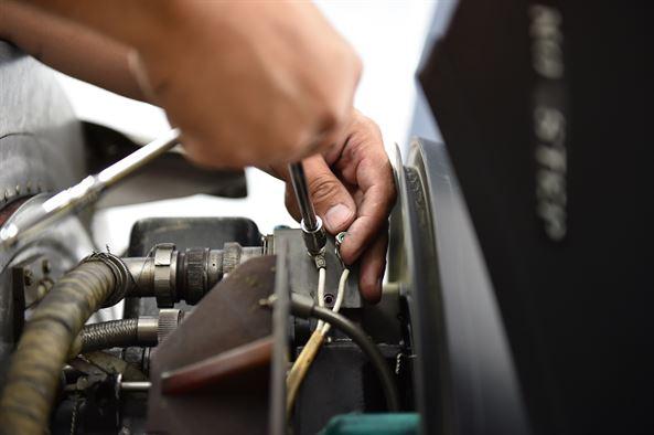 auto electrician fixing a car