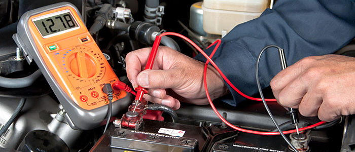 auto electrician fixing the eletronics in a car