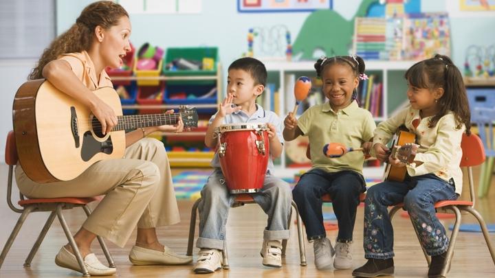 educator helping children learn