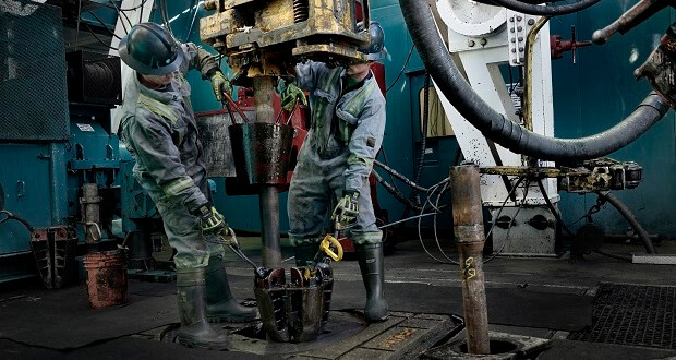 oil riggers at work
